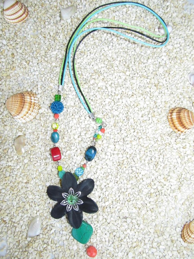 Handmade necklace (1 pc)  Made with leather and metal flower, gemstones, glass beads, leather cords and teal wire bead.