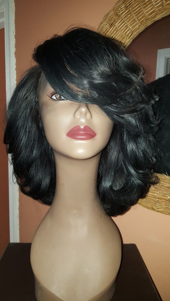 PRODUCT INFORMATION:***Please read carefully. ALL WIG SALES ARE FINAL****7-10 business day processing time (Each wig is custom made. The photos are only a reference to what the unit will look like. You will not receive the unit in the picture).*Shipping is priority 2-3 business days.*Hair from manediva.mayvenn.com*All units come with standard 3 full bundles (3.5 oz. each)   lae OR silk closure in color natural black. Additional bundles are available upon request....