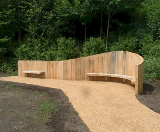 Bespoke curved sleeper wall with integral seat boards