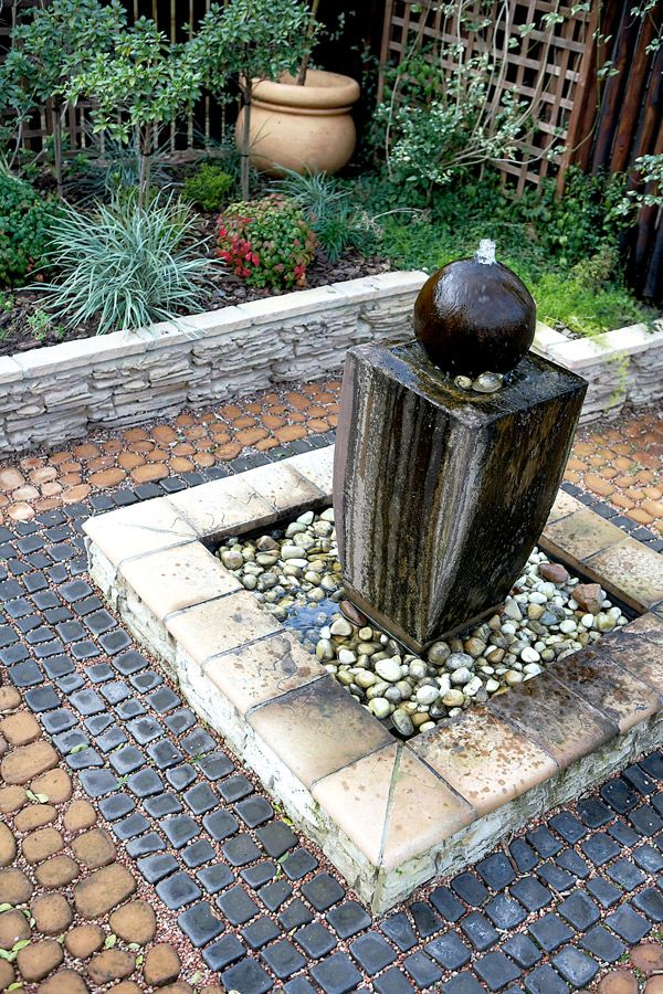 small garden with water features and sitting area google