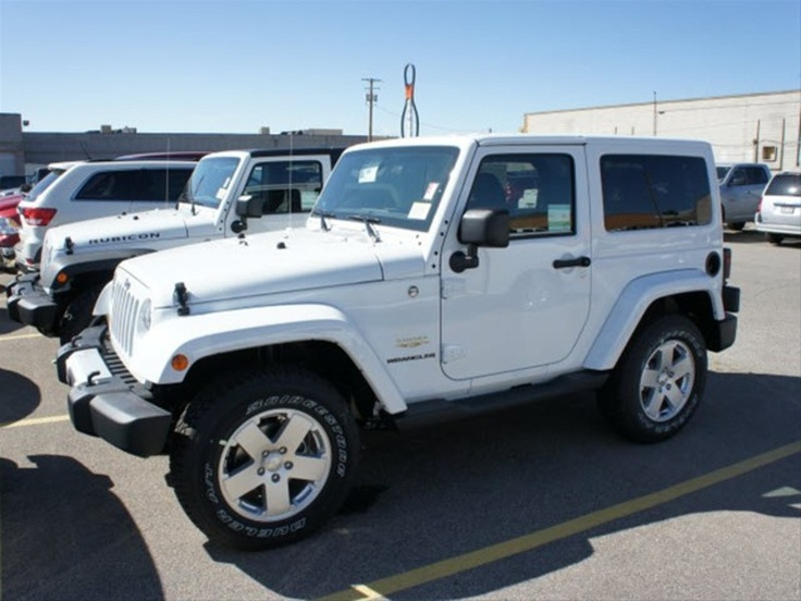 White Jeep Wrangler Sahara. You'll be mine sooner or later. I already named her Jenny! LOL! ( This is me! ) lmao