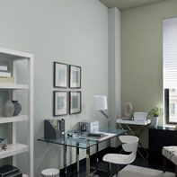 Sophisticated home office painted in a gray color scheme.