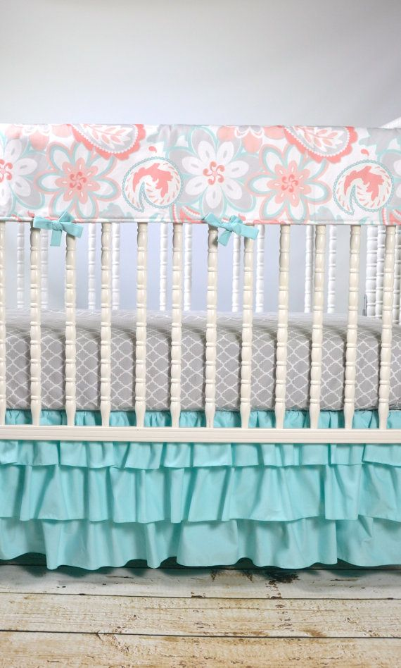 Decorate your nursery using this amazing aqua, gray and coral crib rail cover, sheet and three tiered coral ombre crib skirt. Crib skirt: -15