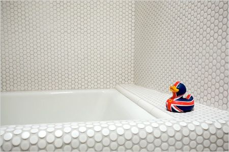 South African-born, LA-based Clive Wilkinson bathroom in his house in West Hollywood using inexpensive penny round tiles from DAL in rctic White 1-inch-by-1-inch penny round tiles.