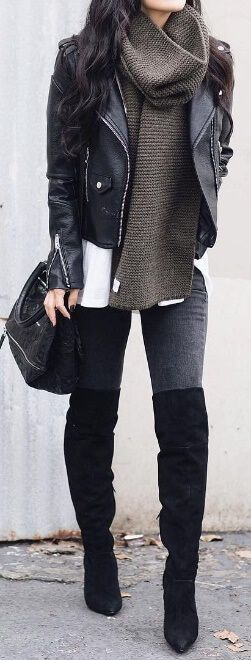 Flaunt your figure no matter what the weather in tight-fitting jeans, knee-high boots, and a sexy leather jacket. To emphasize? A brushed woollen charcoal scarf wrapped elegantly around the neck.