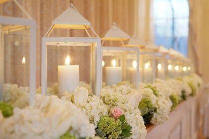 part of my reception centerpiece design. lanterns with candels