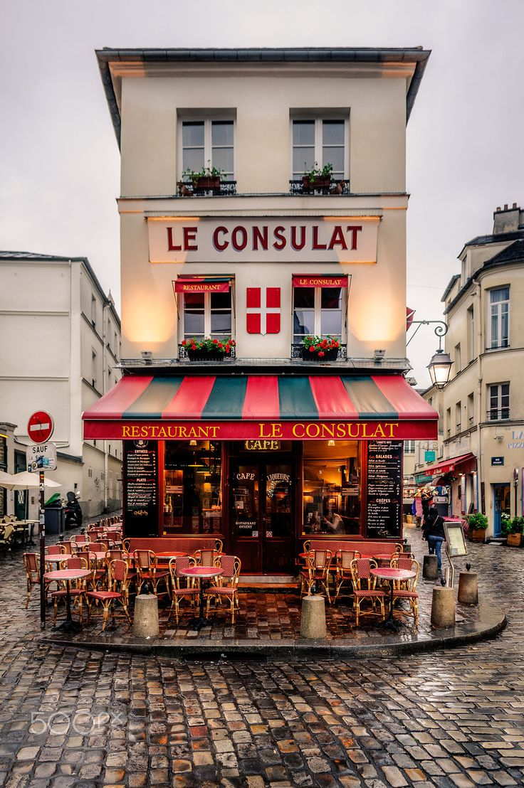 Outdoor cafe in paris with tower in background - Le Consulat Paris France