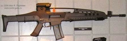 "XM8 rifle in ""automatic rifle"" (light machine gun) configuration.  Note longer barrel and folded bipods under the forearm"