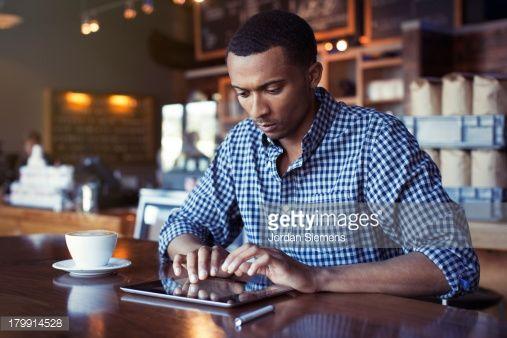 Foto de stock : A man using a digital tablet.