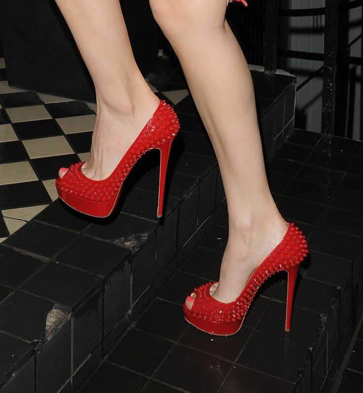 patent red studded christian louboutin lady peeps on the feet of @Kelly Brook #shoeporn #actionshot