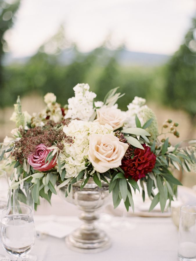 Tuscan inspired rose centerpiece: http://www.stylemepretty.com/little-black-book-blog/2016/05/03/inspired-by-tuscany-this-couple-recreated-that-magic-for-their-big-day/   Photography: Coco Tran - http://www.cocotran.com/