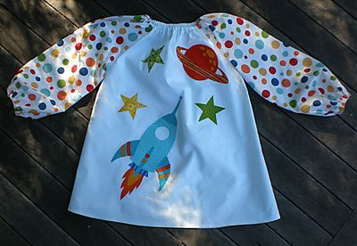 I don't know HOW you'd ever be able to let a kid paint in something this cute, but if the thought justifies the sewing, so be it! :D