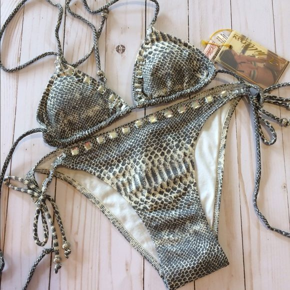 🎉HP🎉Snakeskin jeweled tie side bikini bottoms These gorgeous sexy snakeskin print bottoms are a very skimpy cut. They have functional tie sides.I only have these left in a size 10, large. Please refer to my 2chillies sizing chart for your perfect fit. They are adorned with diamond like jewels and have silver accents on the ties. 2Chillies Swim Bikinis