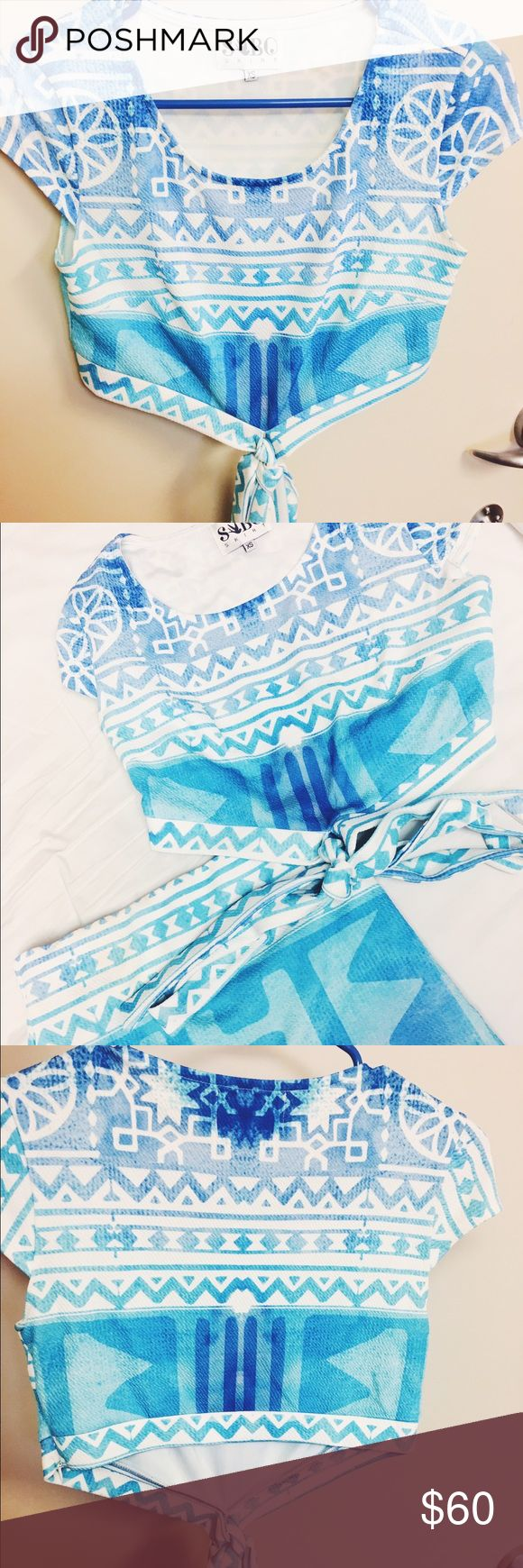 Sabo Skirt beach blue set This supper cute set is great for summer or a standout outfit. The top crosses in the front, for a great style effect and fits so comfortably. Worn 3-4 times, excellent condition! Sabo Skirt Tops Crop Tops