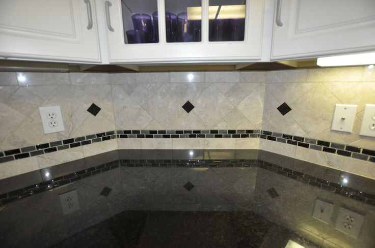 interior design grey and white. black countertop glass marble