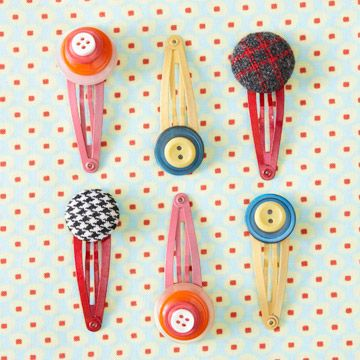 (s) Cute Button Hairclips - Start with buttons stacked up or cover them with fabric, then simply use hot glue (with the supervision of Mom) to attach the buttons to hair clips.  Editor's Tip: Make sure the clip is open when you attach the buttons and let them dry overnight before use.