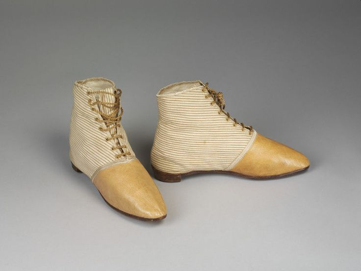 Pair of boots Place of origin: Great Britain, Uk (made) Date:  1815-1820 (made) Artist/Maker: Unknown (production) Materials and Techniques:  Cotton, leather      and lacing Museum number: T.190&A-1927 Gallery location:  In Storage