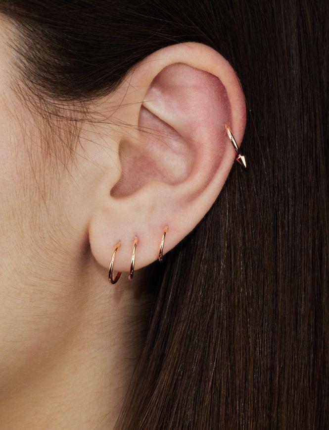 Lots of gold hoops on ear.