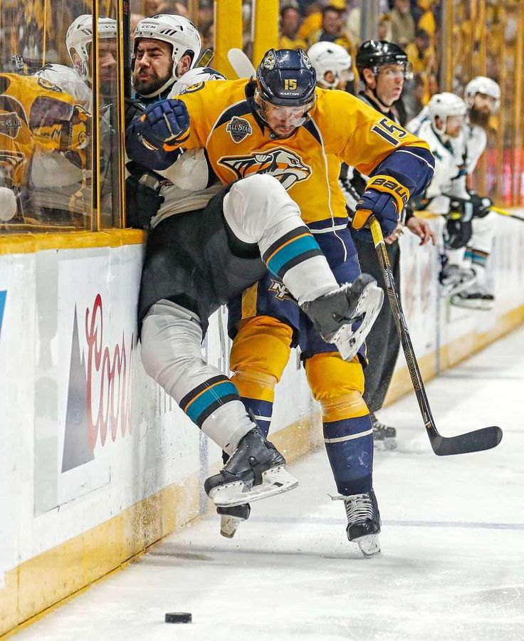 Up against it: Craig Smith of the Nashville Predators checks Roman Polak of the San Jose Sharks into the boards during Game 6 of the Western Conference semifinals on May 9 in Nashville, Tenn. The Predators won 4-3 in OT.
