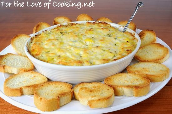 We had friends over to watch the election coverage and we had a smorgasbord of appetizers to munch on through the night. I made this crab and artichoke dip and served it with crostini. It took only a