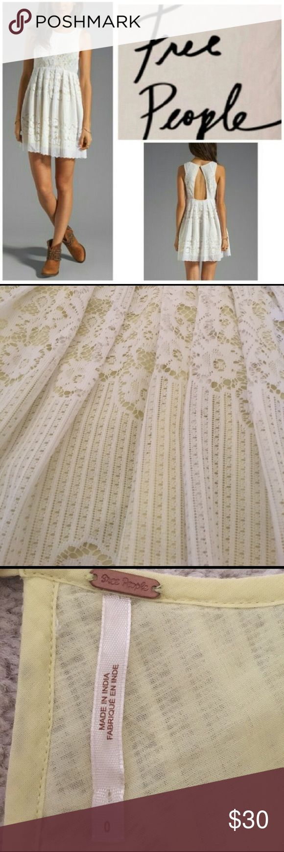Free People White Lace Dress Perfect summer dress. Light white Lace with pale yellow lining and keyhole back. Worn once and is in mint condition. Babydoll Chić! Free People Dresses