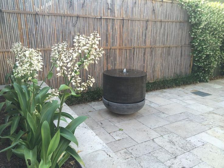 water feature and japanese screen fence