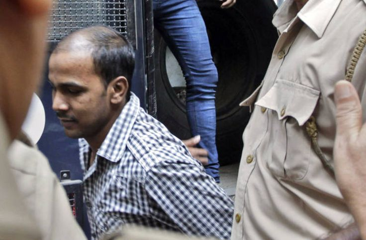Mukesh Singh, center, and Vinay Sharma, two of the four men sentenced to death for raping and torturing a young woman on a moving bus, alight from a police van outside the High Court in New Delhi, India, Tuesday, Sept. 24, 2013. Lawyers for the four men challenged the convictions and death sentences at a High Court hearing Tuesday. The brutal attack in December sparked public debate and fury over chronic sexual violence faced by women in India. (AP Photo/Tsering Topgyal)