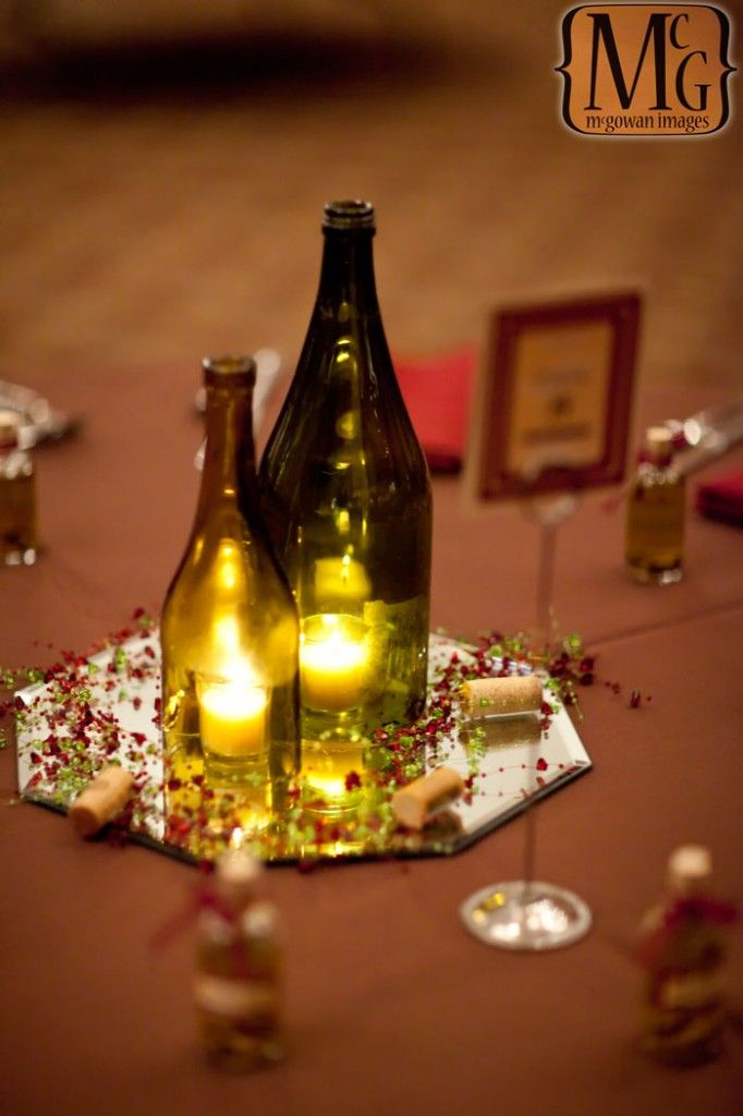 17 best images about wedding centerpiece ideas on for Wedding table decorations with wine bottles