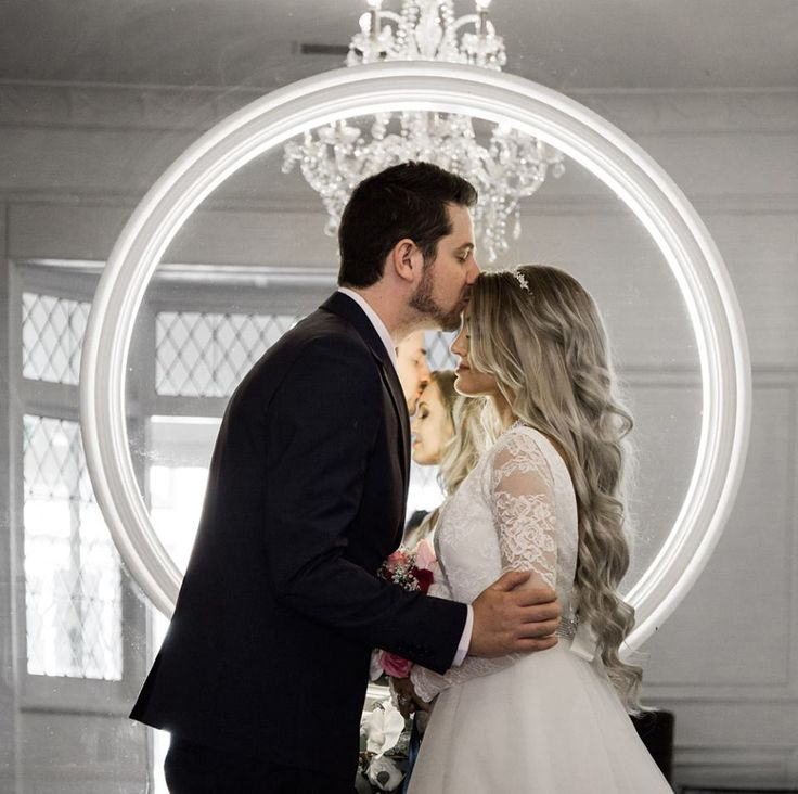 Bride and groom kissing infront of mirror inside Caversham House, Perth  Timika Prygoda Woodnote Photography