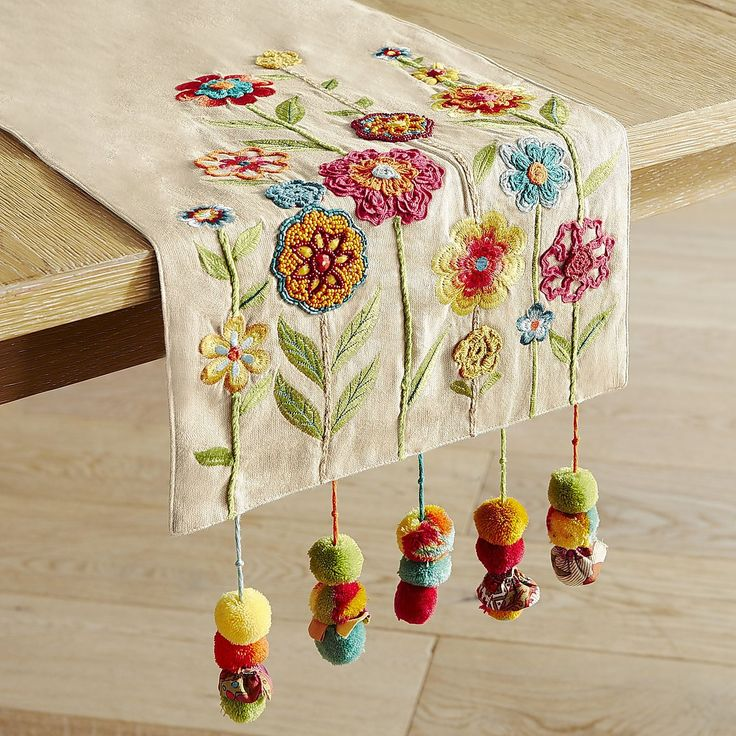 Something to cheer about: Our brightly colored table runner with embroidered and…