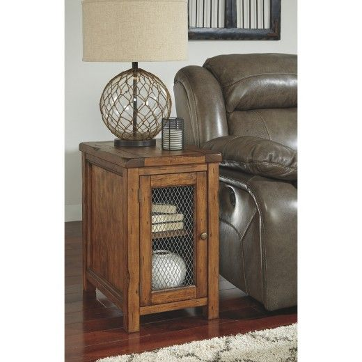 Heavy distressing, chiseled edges and a rustic finish lend Tamonie chairside end table an earthy, farmhouse feel. Storage cabinet holds accessories and collectibles. Wire mesh door panel provides a peek inside at your favorite things. Signature Design by Ashley is a registered trademark of Ashley Furniture Industries, Inc.