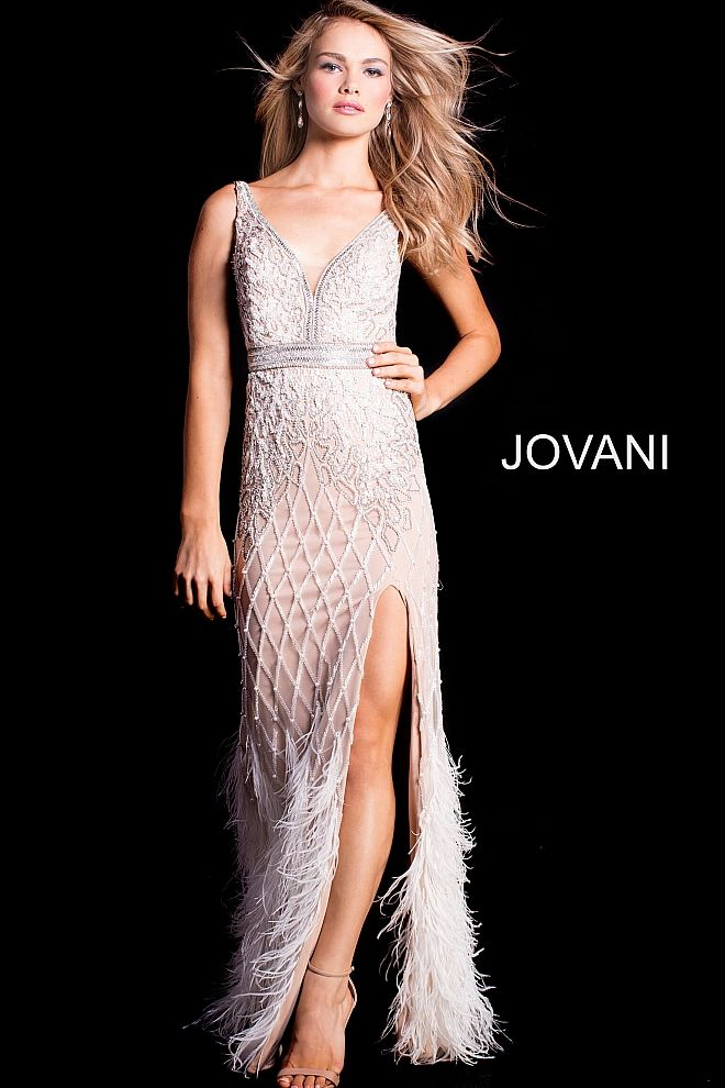 9f05042b1a41 Floor length form fitting ivory embellished prom dress with nude underlay  and high slit features feather bottom skirt and sleeveless bodice with v  neck.