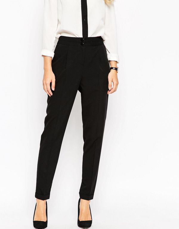 Tailored High Waist Pants: If dancing in a short dress is your idea of torture, pull on these tailored trousers and jump on the dance floor to show off your moves. While they're still frilly enough for a stylish wedding look, you can achieve coveted comfort with a cutting edge outfit.  | Wedding Guest Style: What to Wear to a Wedding When You Don't Want to Wear a Dress