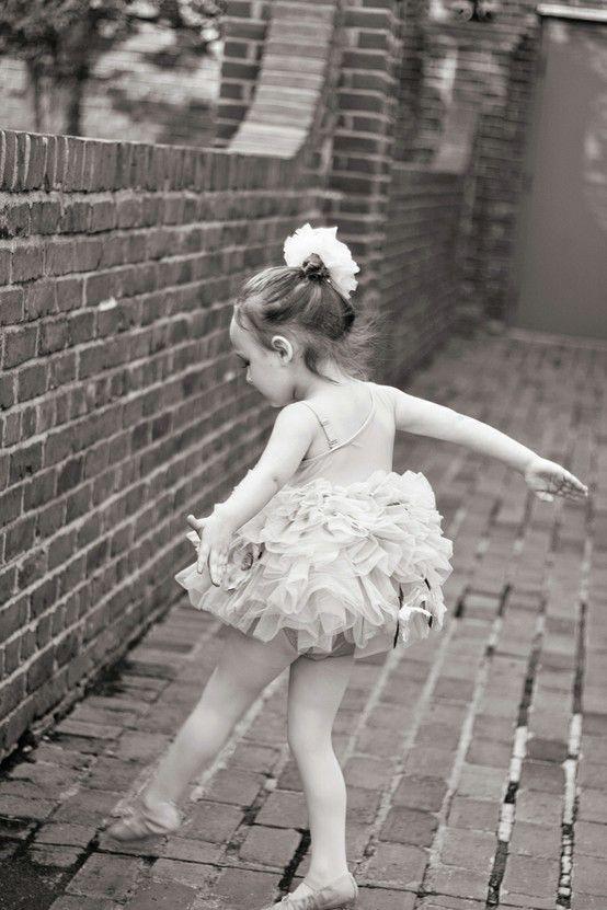little girl dancing. little ballerina black and white ...