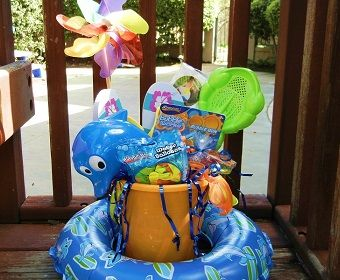 Fun in the Sun Basket - This Fun in the Sun Easter Basket is great for kids who love the beach! Stock up on all of the affordable supplies they'll need for summer like a beach towel, sunglasses, beach balls, sidewalk chalk, flip flops and more. Top it off with Fun Flip Flop Cookies, gummy fish and goldfish crackers.