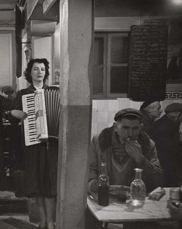 Robert Doisneau. Accordionist Playing in a Bistro near Les ...