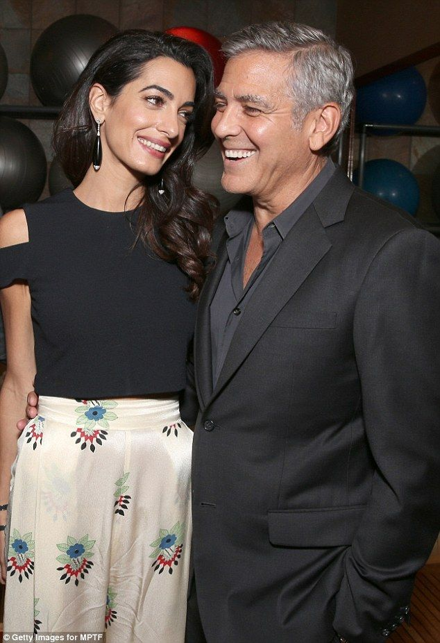 That look of love: Amal Clooney looked absolutely smitten as she gazed lovingly at her hus...