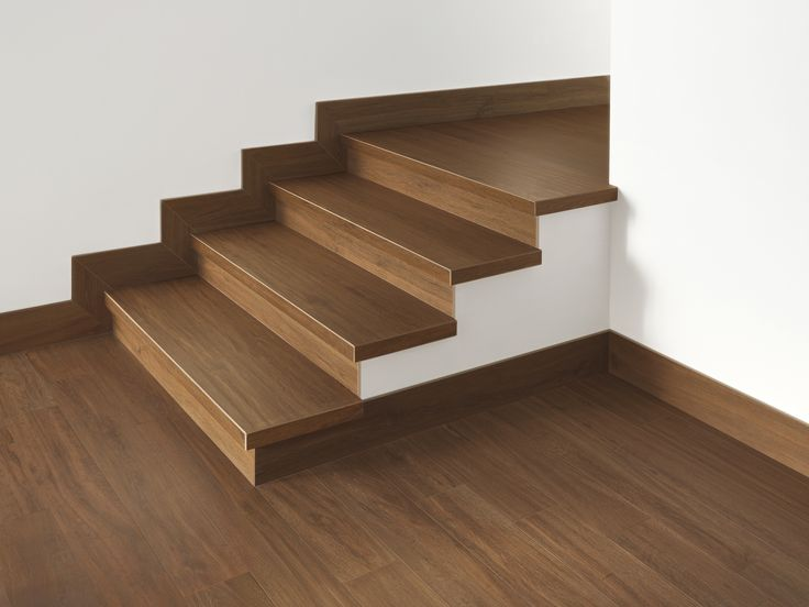 Brilliant timber staircase and flooring using fantastic timber-look porcelain tiles.
