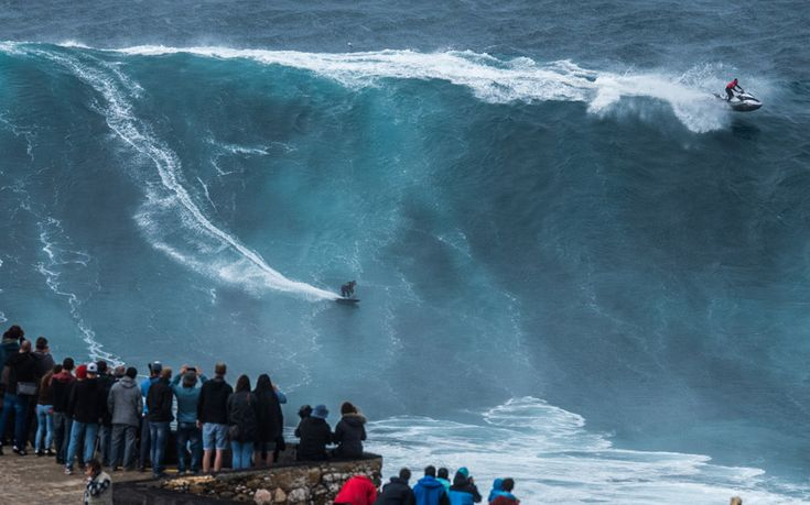 Surfer stuns crowd on huge wave in Portugal - via The Telegrapgh 28.10.2015   German surfer, Sebastian Steudtner, wows crowds in Portugal while   riding a massive wave in the first big swell of the year. Crowds gathered to watch brave surfers take on massive waves at Praia do Norte in Nazare, Portugal.