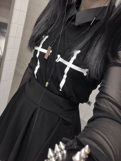 (nu?) goth fashion. bones + crosses. all black. silver spiked bracelet. <3 collar <3