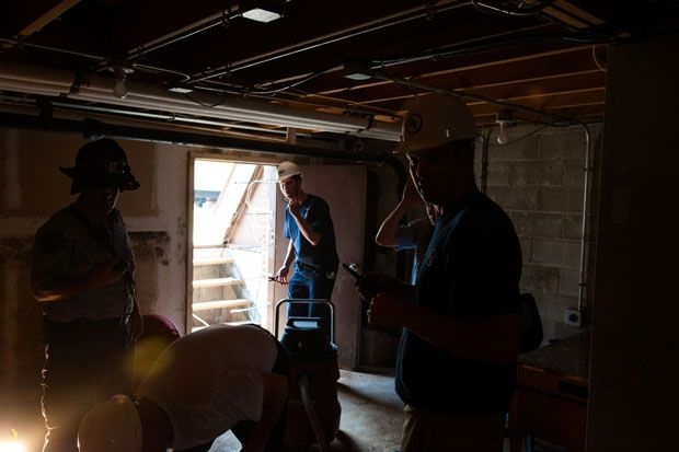 UL testing experts set up an experiment in the basement of an abandoned home.