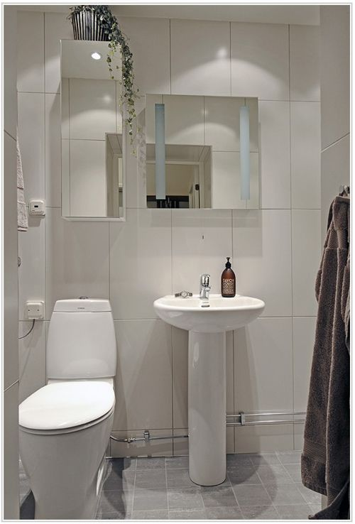 bathroom interesting white bathroom design ideas using white ceramic tile bathroom wall along with round white pedestal bathroom sink and bathroom mirror