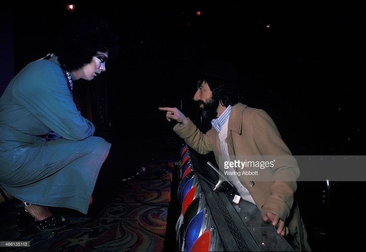 Actor Tim Curry and producer Lou Adler speaking during the original American production of The Rocky Horror Picture Show at the Belasco Theater on March 10, 1975 in New York City.