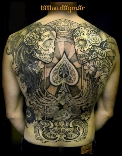 Black and grey Dia De Los Muertos inspired back piece done by Tattoo Dagmar.