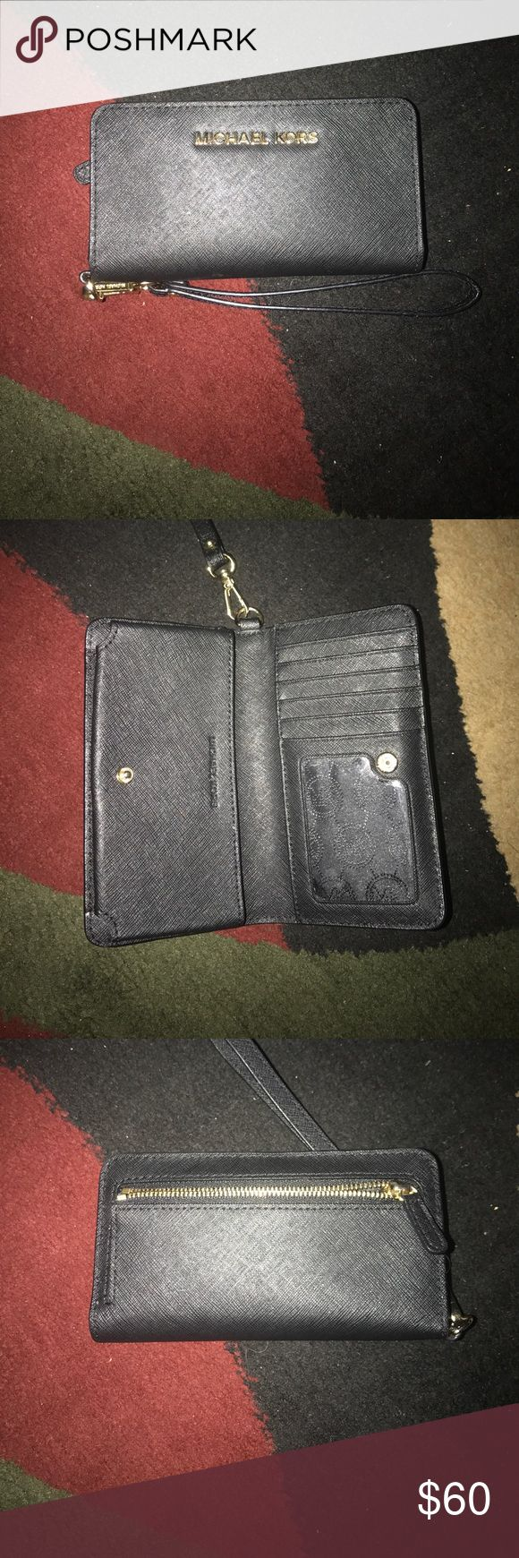 MICHAEL KORS iPhone6/6s phone case wallet Perfect condition no ware and tear great for on the go gals who doesn't love to tote large handbags everywhere !!! Michael Kors Bags Wallets