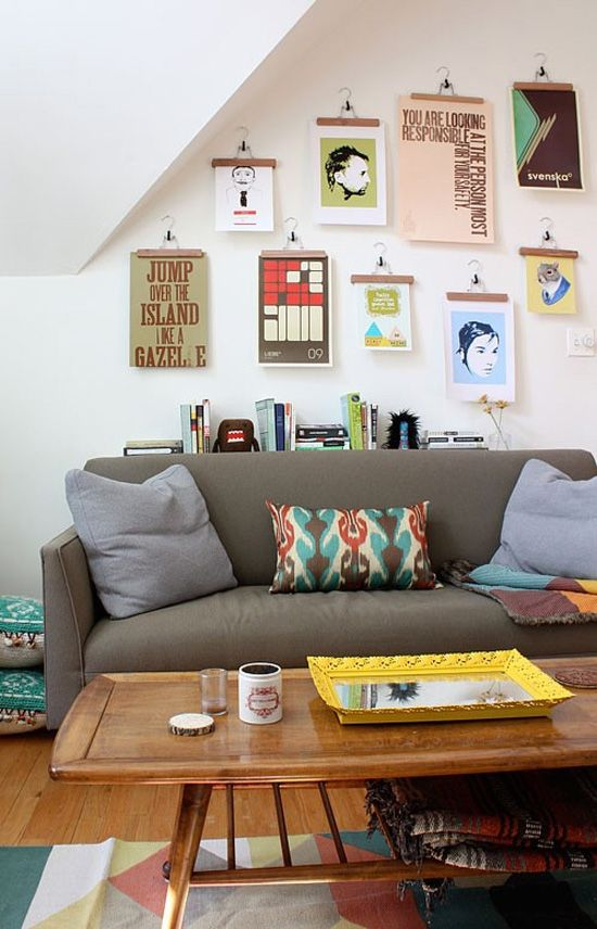 """cool way to hang photos and artwork - having all the same """"frame"""" gives it some cohesion..."""