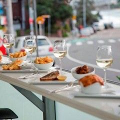 Bondi's Best - Relax and indulge in a simple meal of fish and chips while overlooking Bondi Beach.