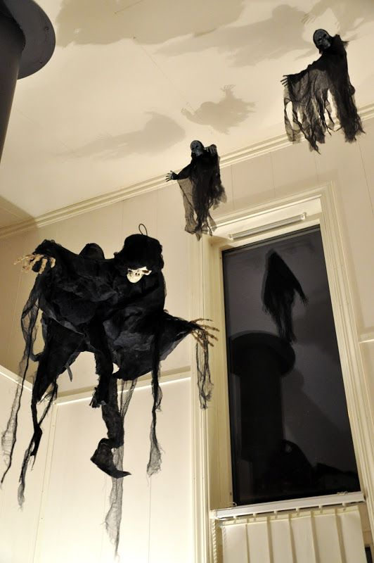 halloween party haunted house decor dementors from black gauze and small skulls and skeletal hands