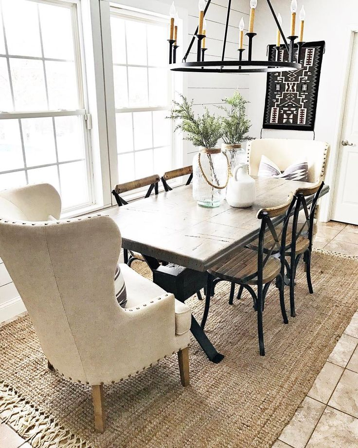 Love the chandelier, though maybe a smaller one for this size table would be better. Love the furniture!