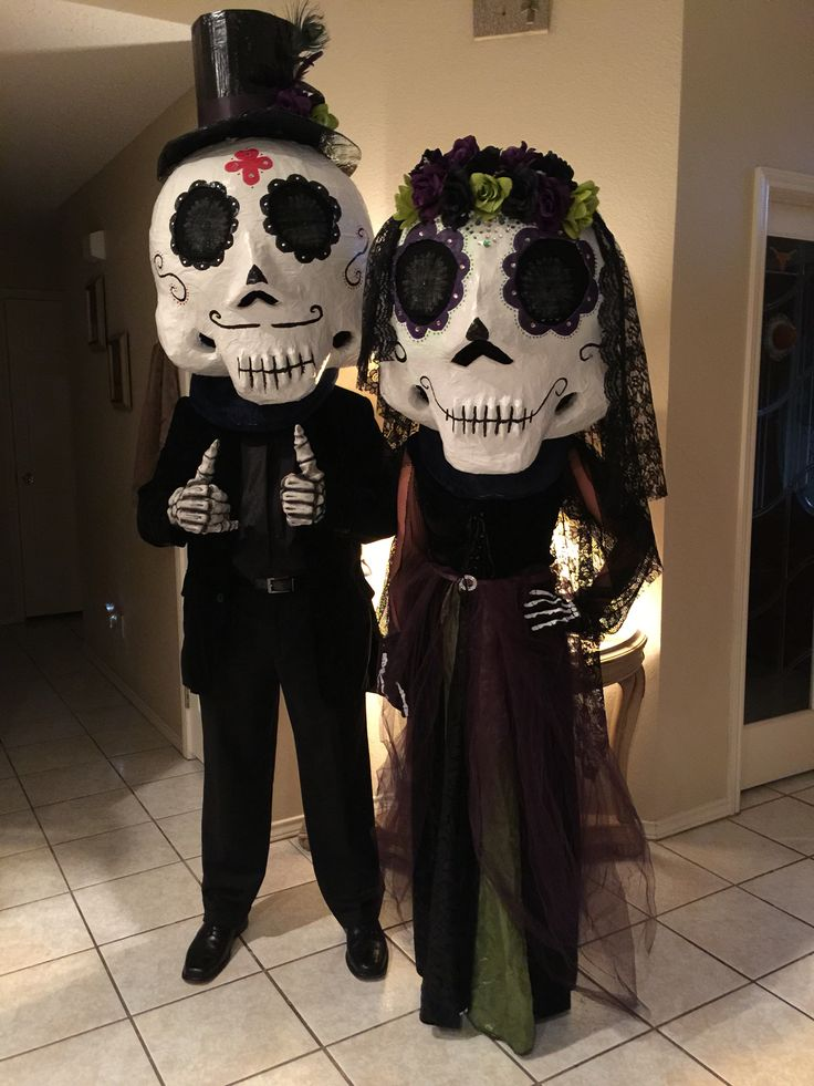 Day of dead couple...  Paper mache mask...  Day of the dead masks
